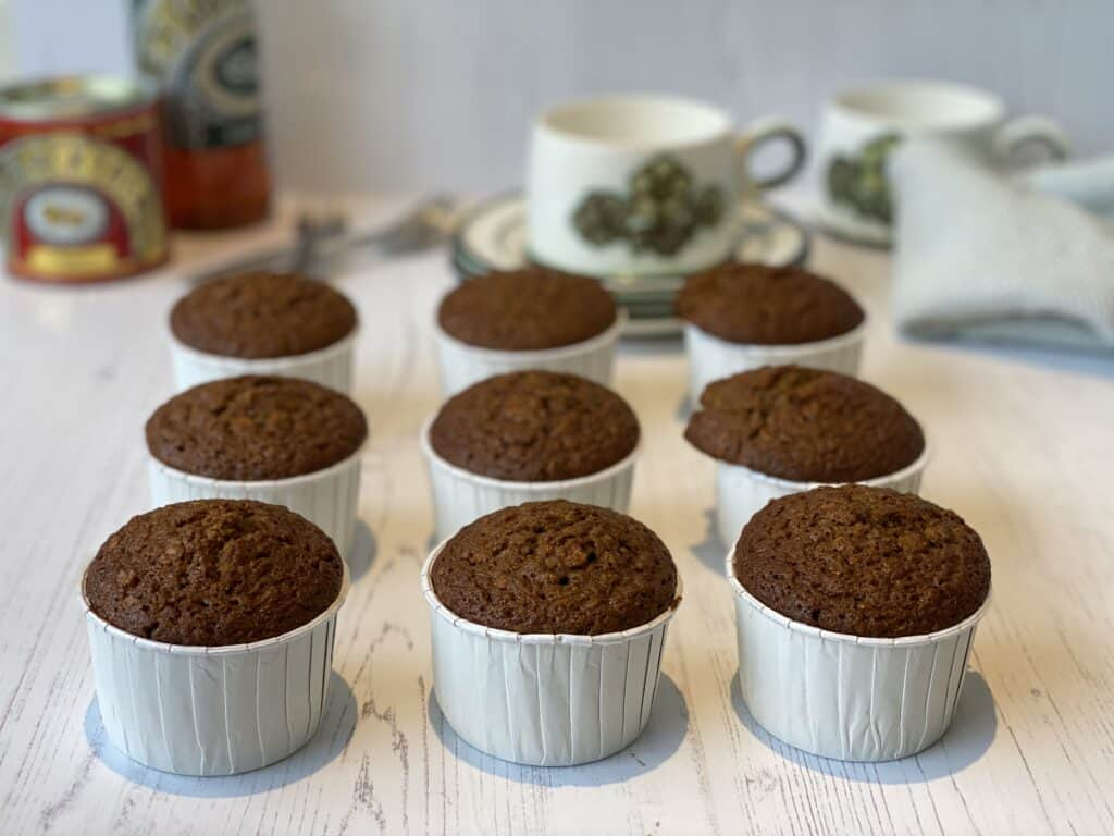 9 Treacle and Oat Muffins on a white board