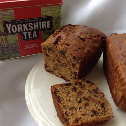 Yorkshire Tea loaf on a plate with a Yorkshire Tea, tea caddy.