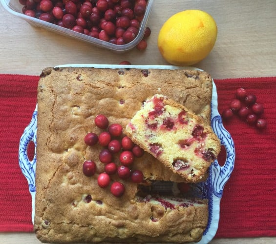 Cranberry and Orange cake on a blue plate