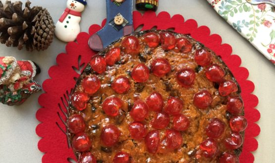 whole Fruit Cake on a red serving mat