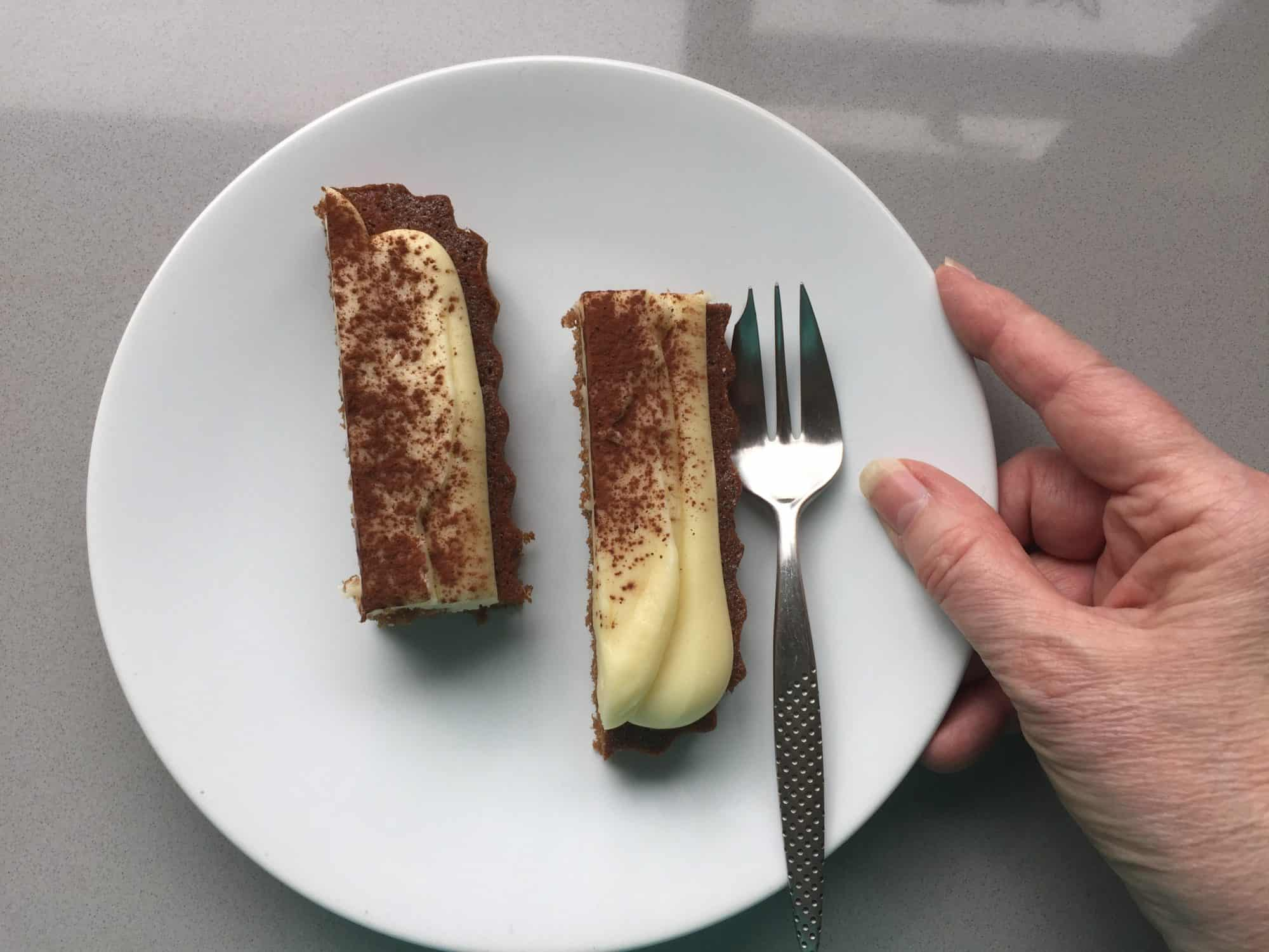 Slices of cakes on a white plate