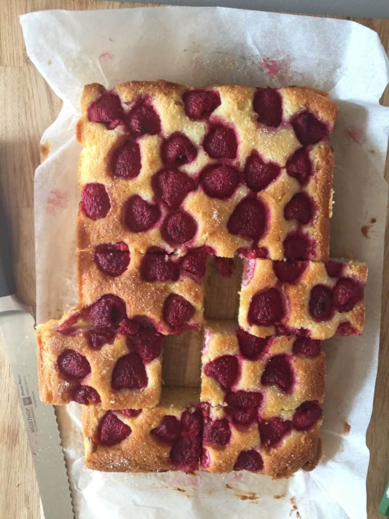 Raspberry and Almond Traybake with slices cut out