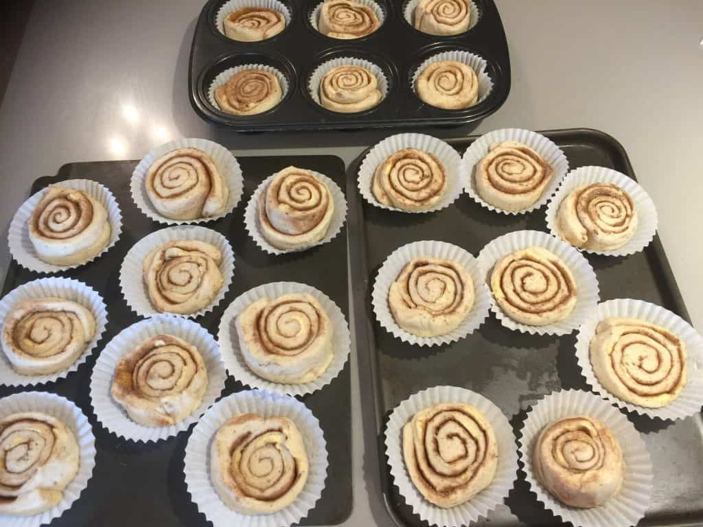 Cinnamon Buns ready to bake on baking trays