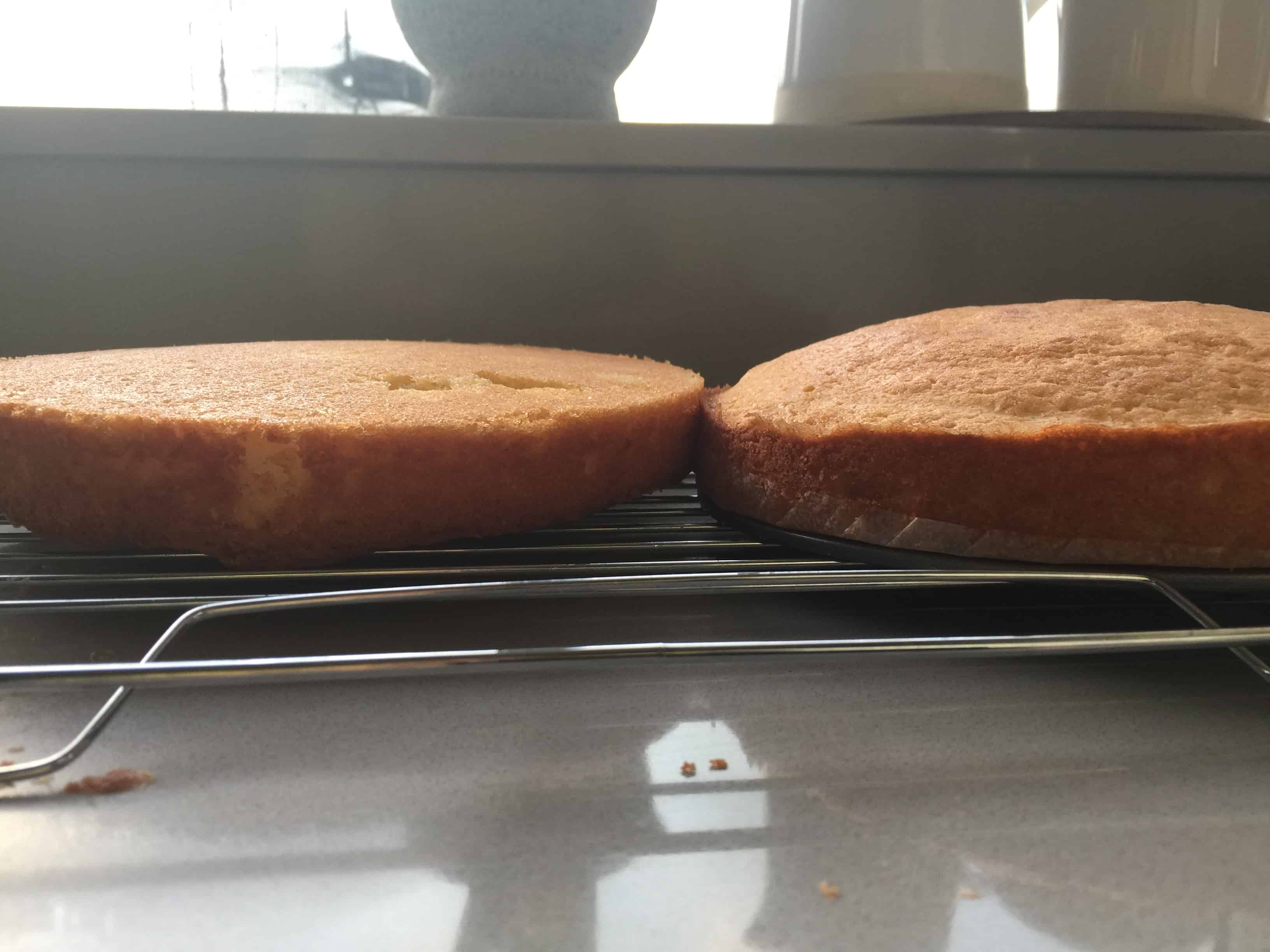 two baked vanilla sponge cakes on a wire rack cooling for victoria sandwich