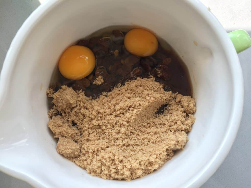 Mixed Dried Fruit, eggs and sugar in a Mason Cash Mixing jug.