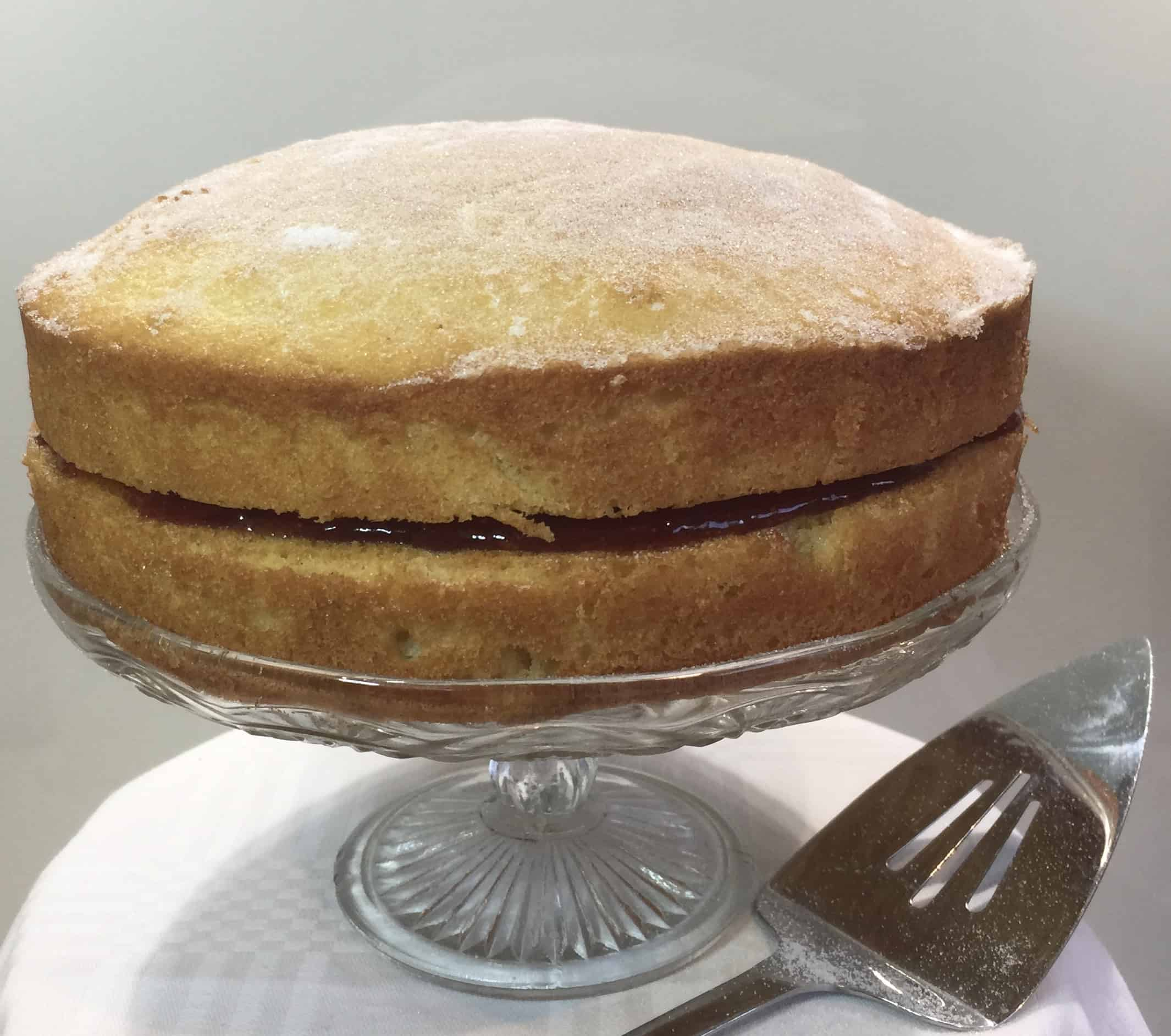 Traditional Victoria Sandwich Cake on a cake stand