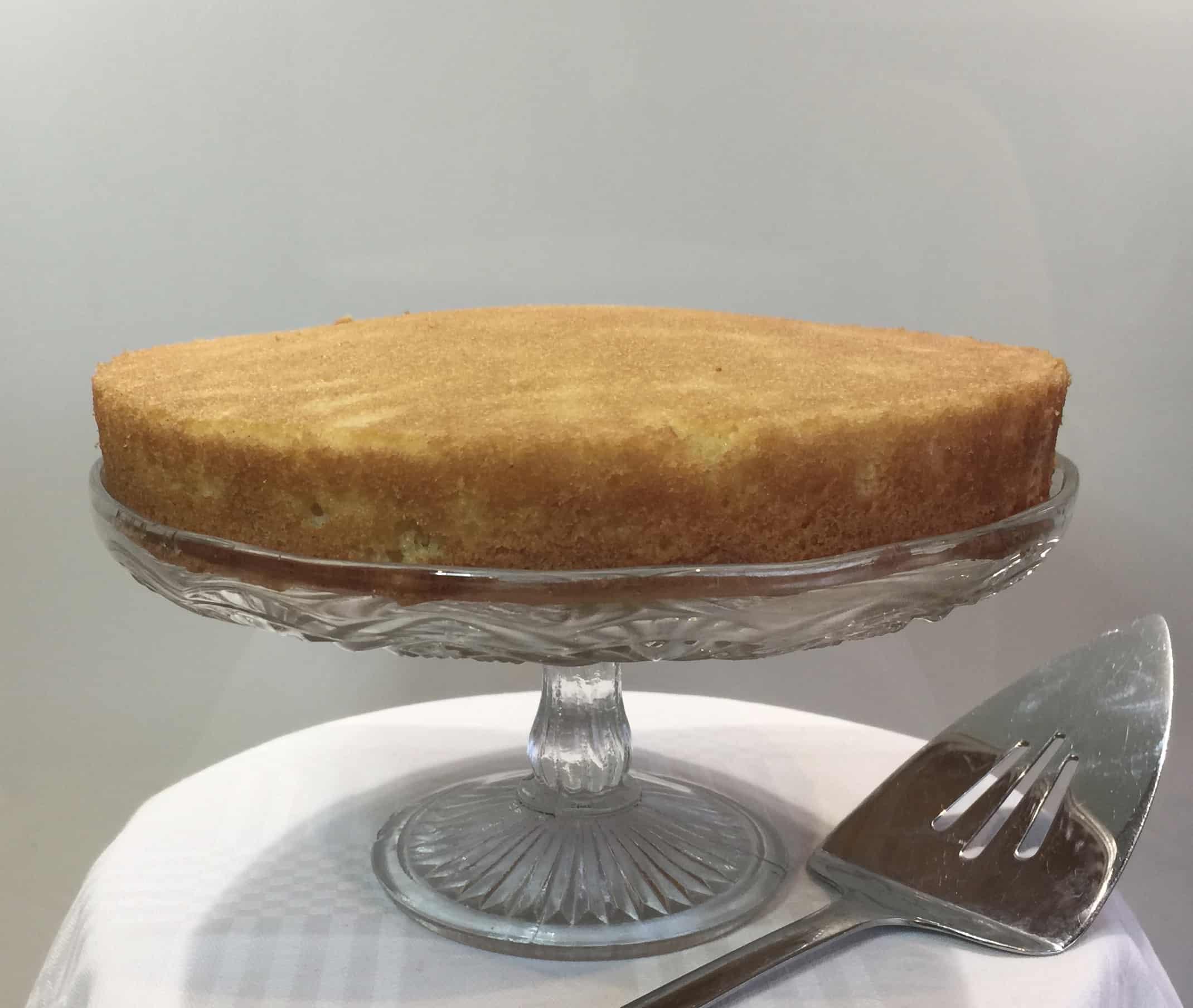 vanilla sponge cake on a cake stand