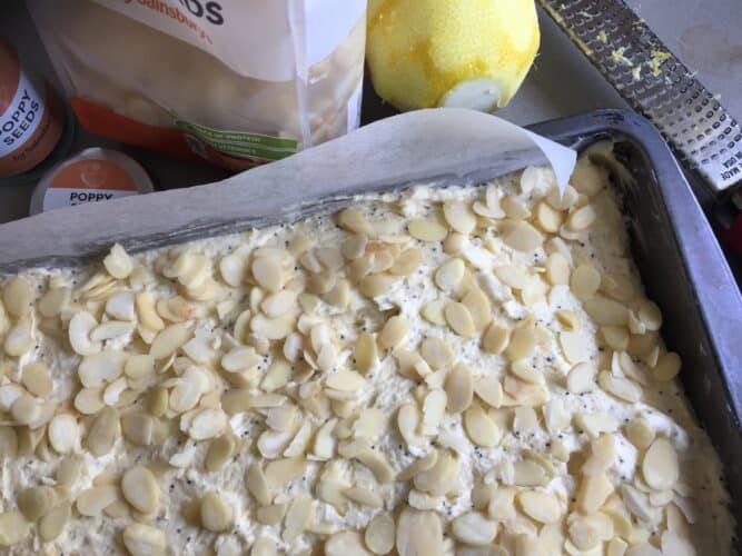 Lemon, Almond poppy seed cake mixture sprinkled with flaked almonds