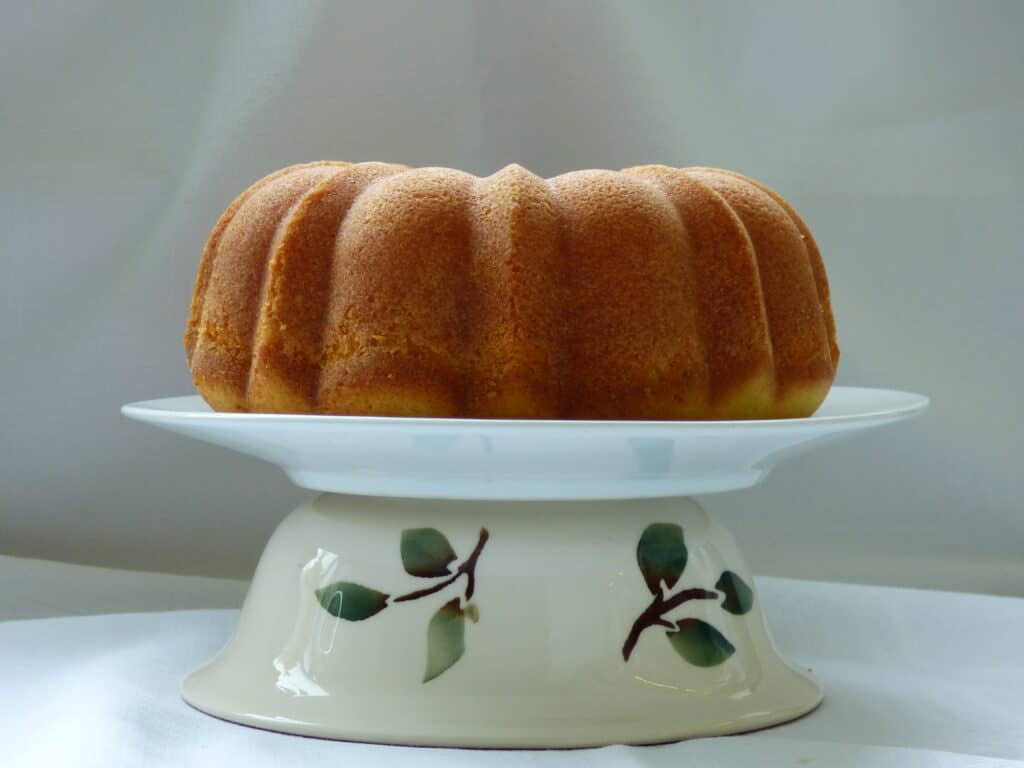Vanilla Bundt cake on a white plate and Emme Bridgwater dish.