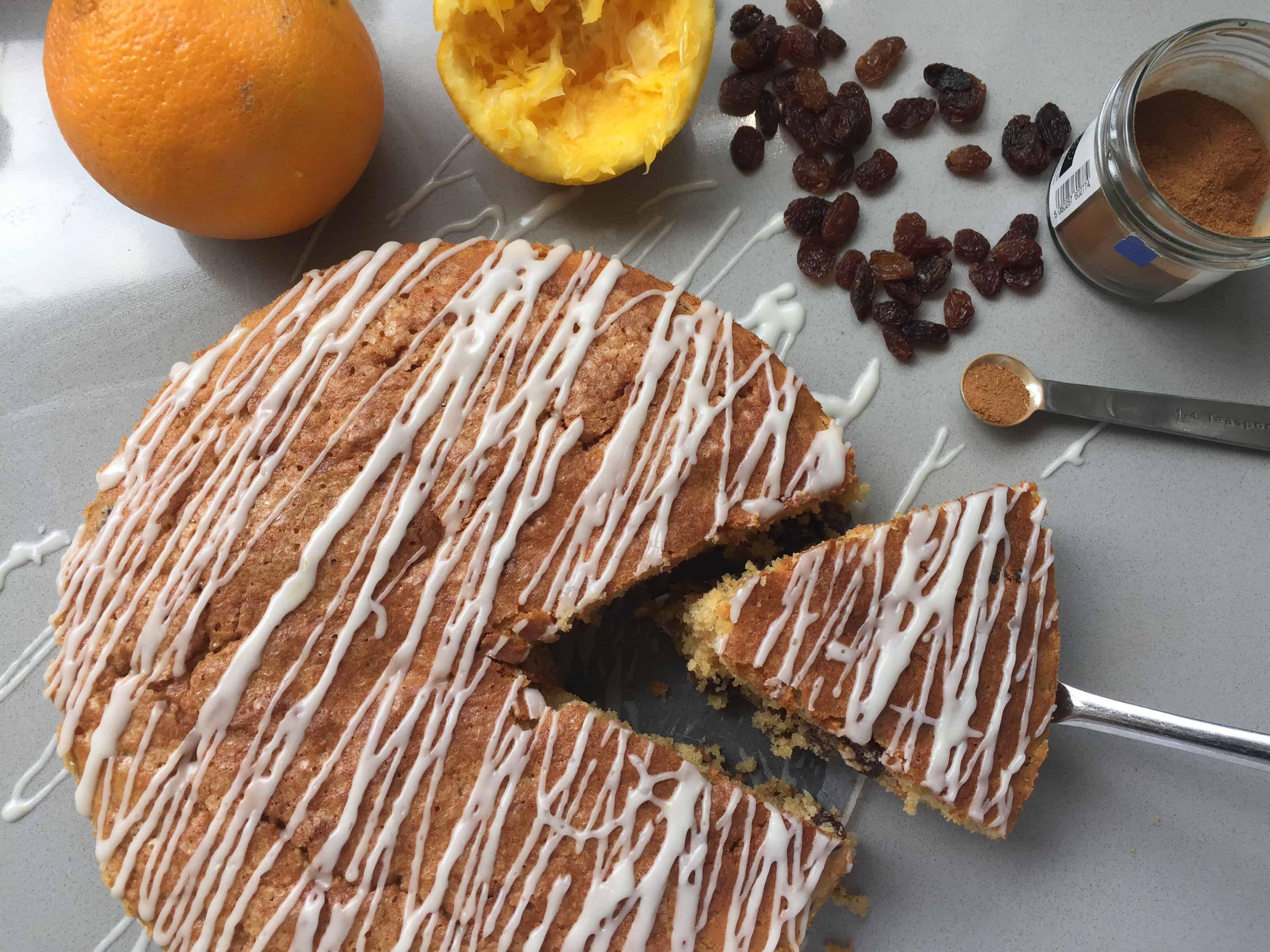 Overhead shot of a sliced cake on a grey counter top.