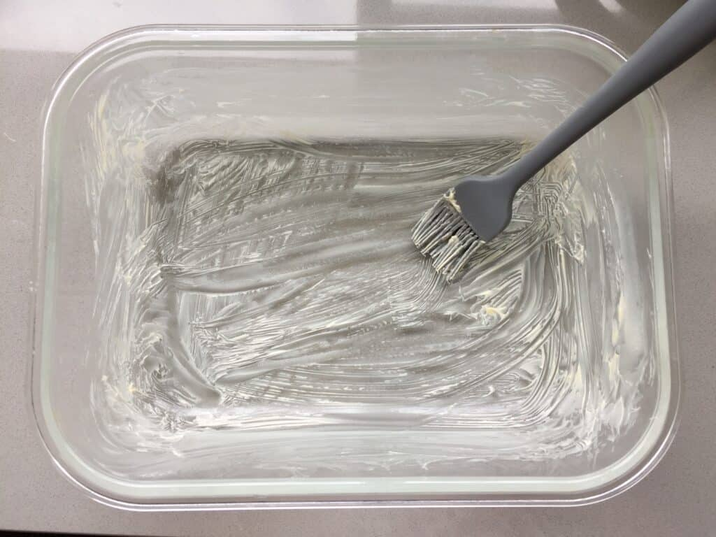 Ovenproof dish lined with butter