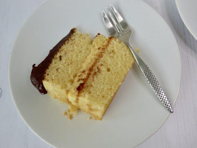 Slice of boston cream pie cake