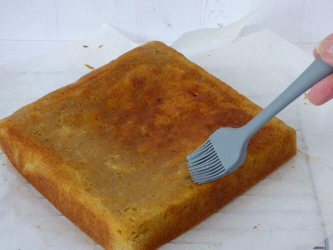 Glazing a square sponge cake