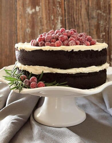 Festive Chocolate cake with white icing and sugared cranberries