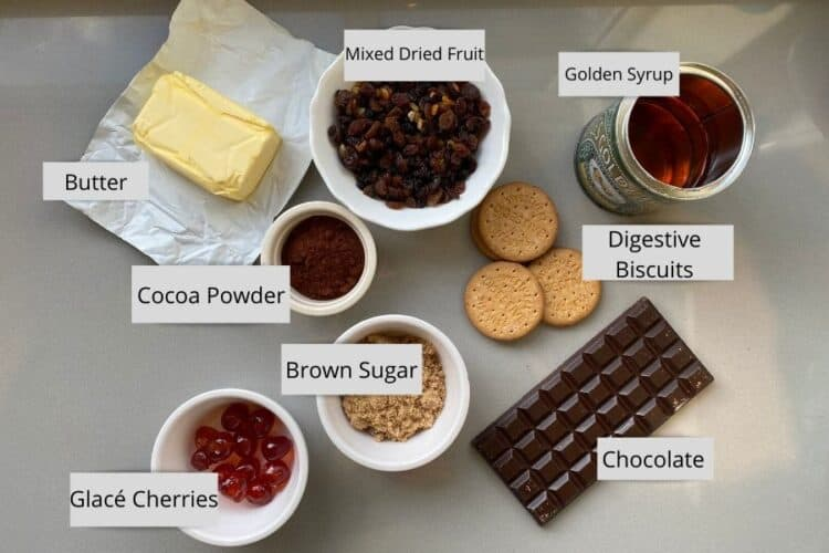 Ingredients for Chocolate Tiffin in individual bowls on a counter top