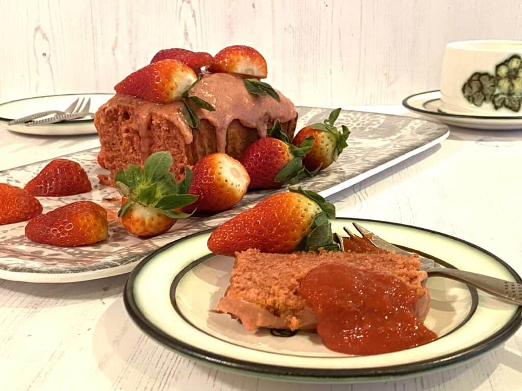 Strawberry cake with a slice cut out