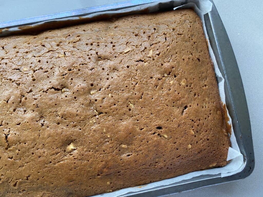 Baked walnut cake unsliced and un-iced in tin