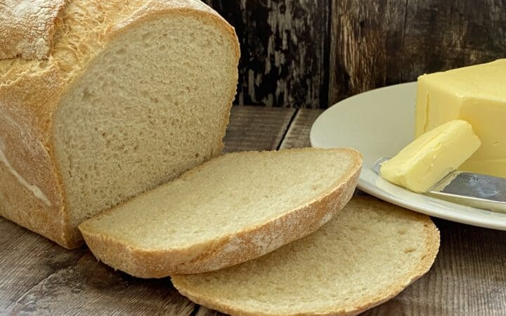 Sliced bread with a dish of butter on the side