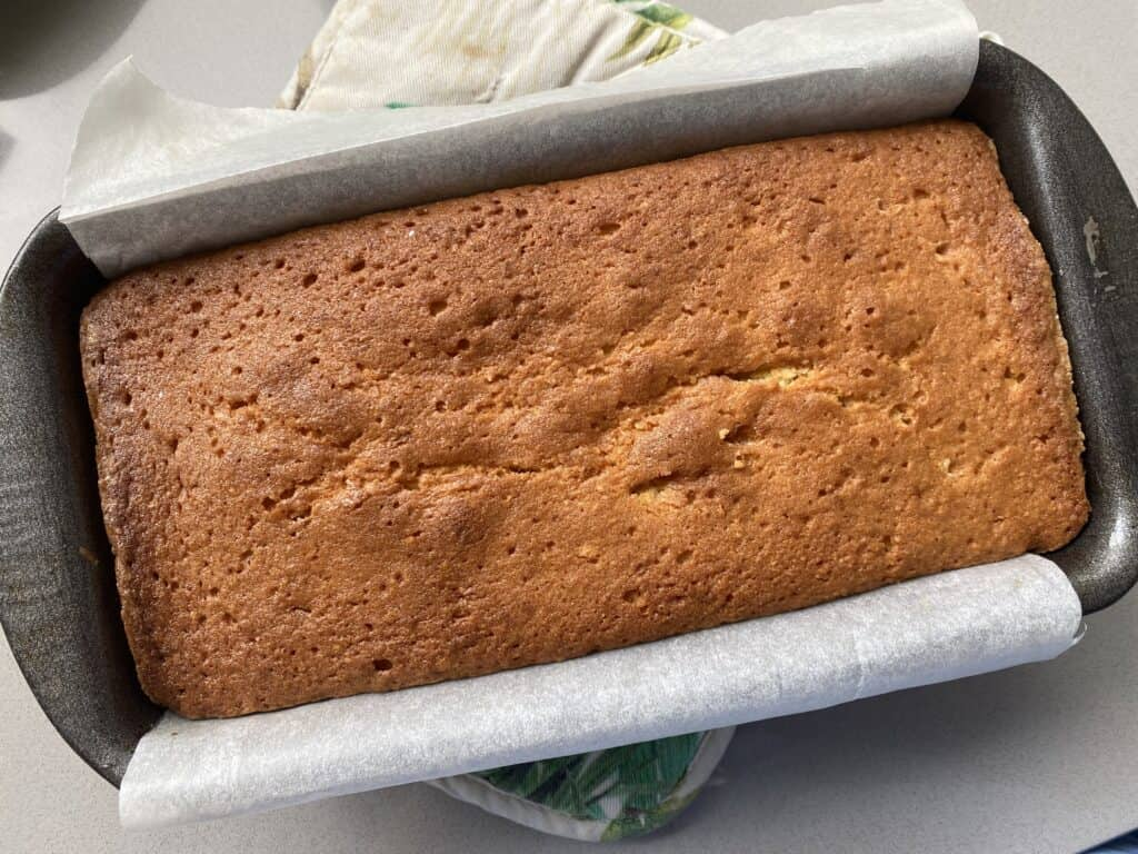 Baked cake in a 2lb loaf tin.