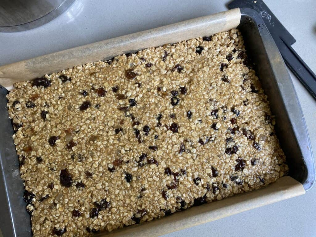 Flapjack mixture in a baking tray