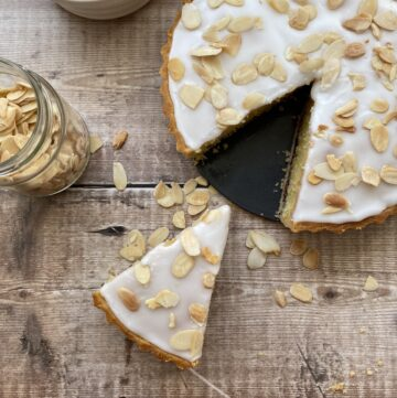 Overhead shot of Bakewell Tart with a slice cut out