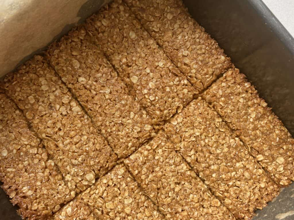 Overhead shot of flapjacks sliced into granola bar sized cuts