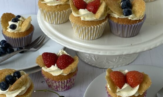 Small cakes on a white cake stand