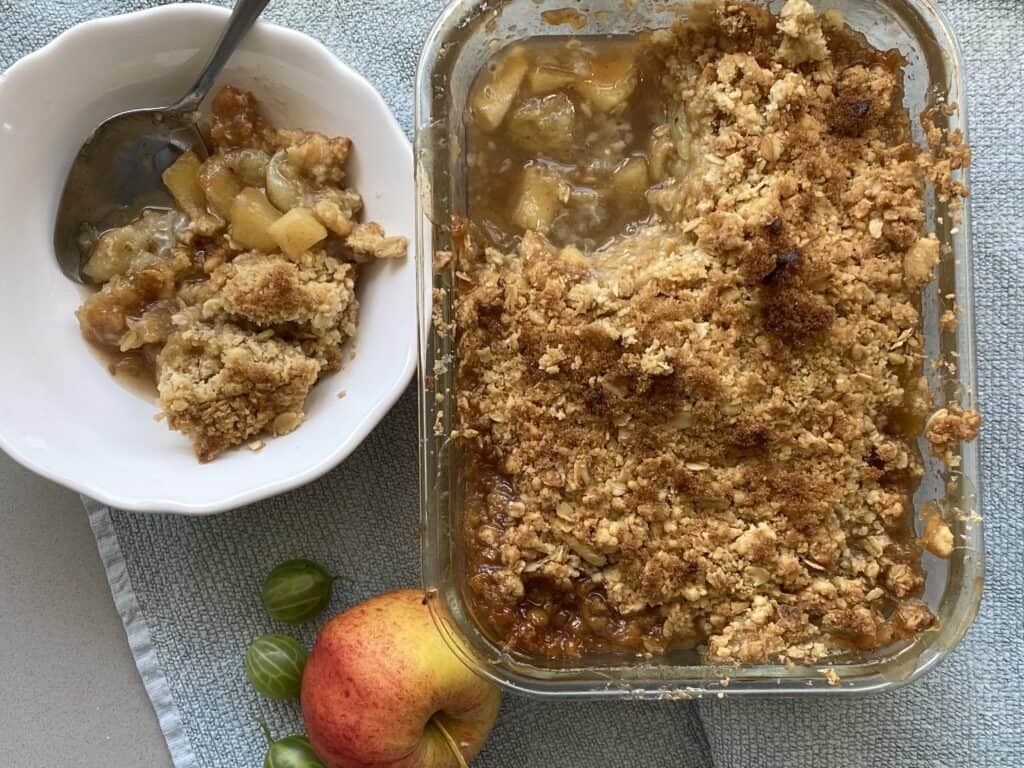 Serving of Gooseberry and Apple Crumble in a white dish