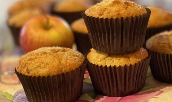 muffins and a red apple.