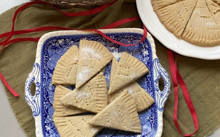 Shortbread biscuits on a blue square plate.