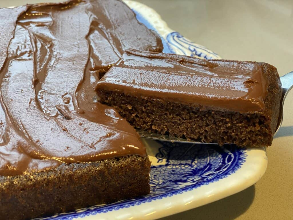 Slice of chocolate cake on a blue plate