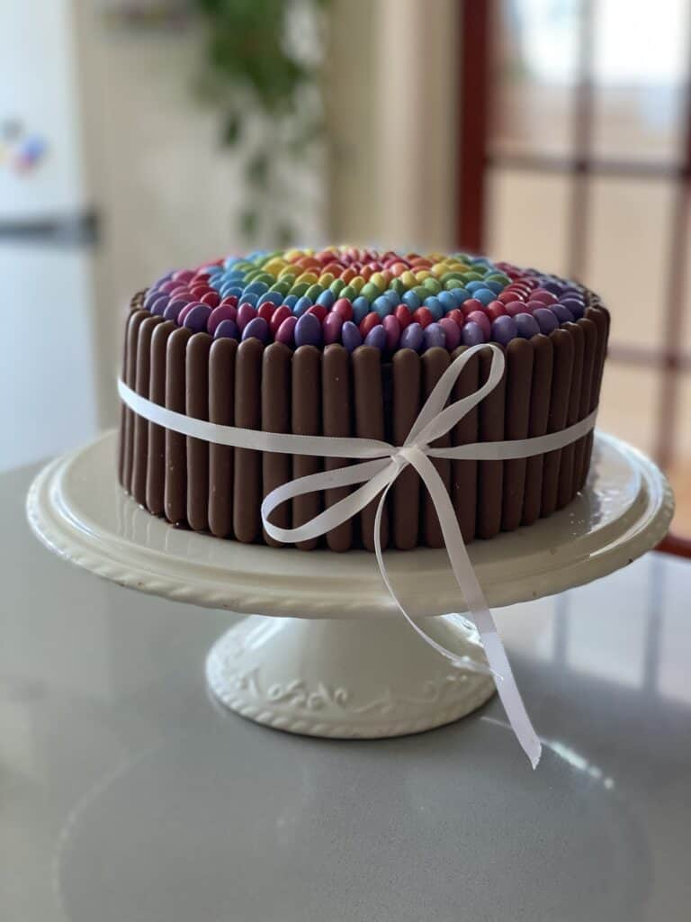 Chocolate Smarties Cake on a white cake stand