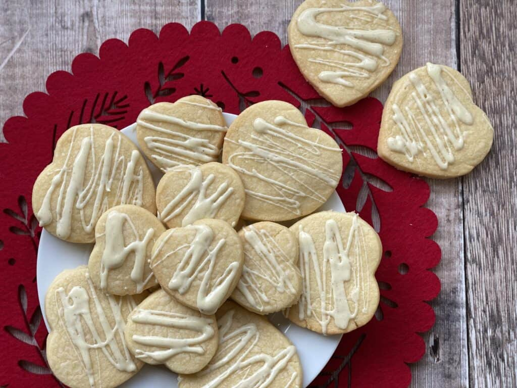 Heart shaped biscuits on a plate and red serving mat