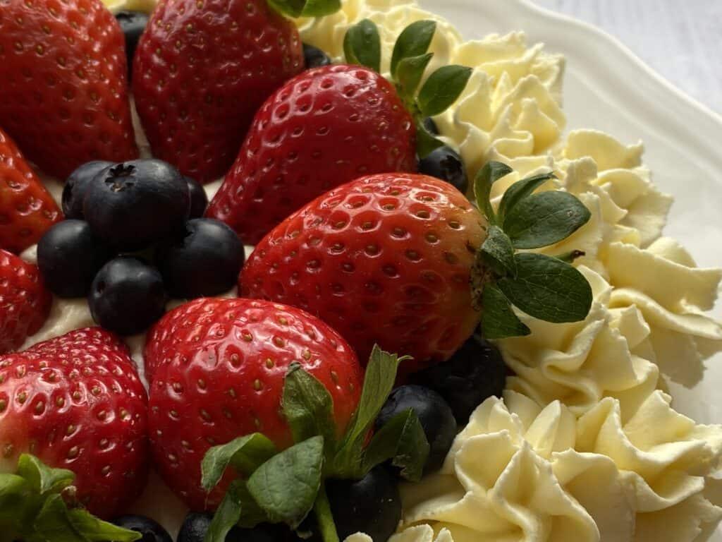 Close up of a fresh berry cake with cream