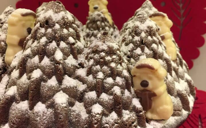Bundt Cake with chite chocolate snowmen as decorations