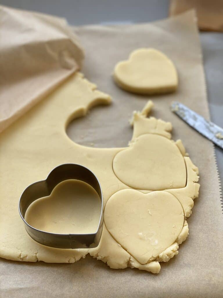 Biscuit dough and cookie cutters