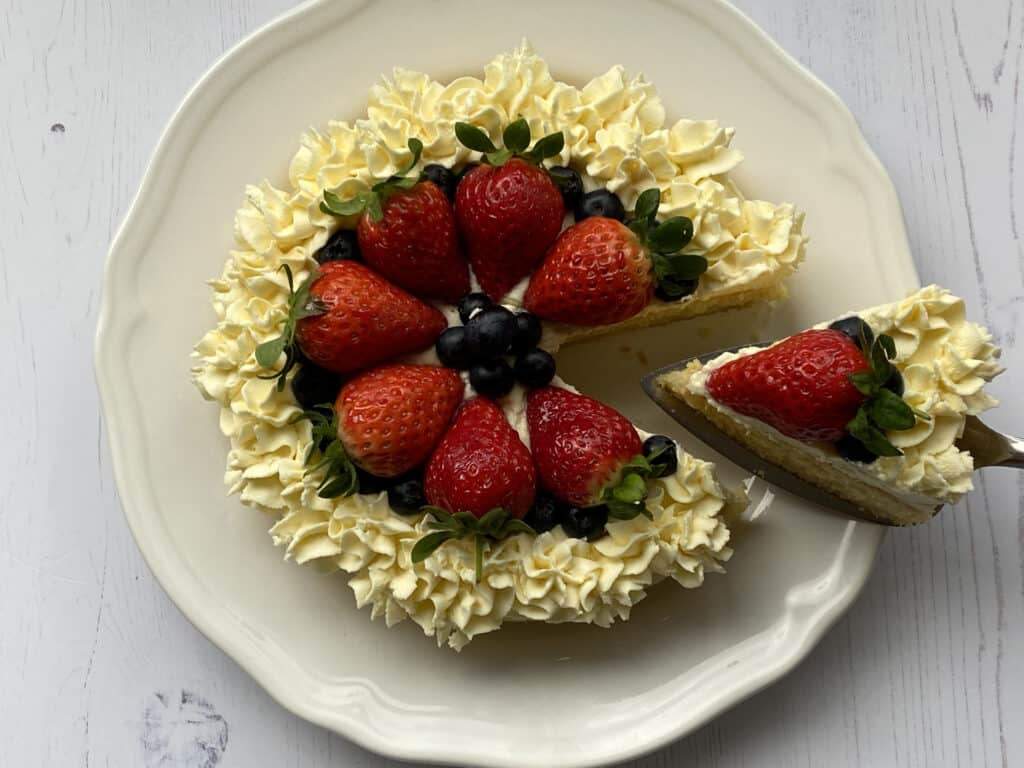 Summer Berry Cake with a slice cut out.