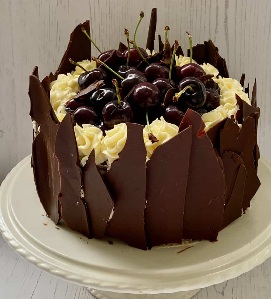 Cherry Black Forest Cake on a white plate.