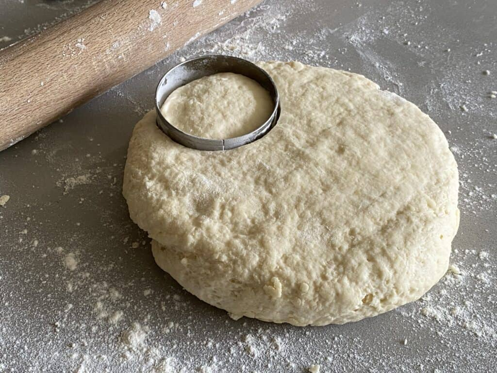 Cutting scone dough with a pastry cutter