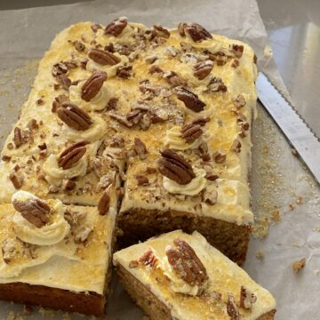 Pecan Cake with a slice cut out.