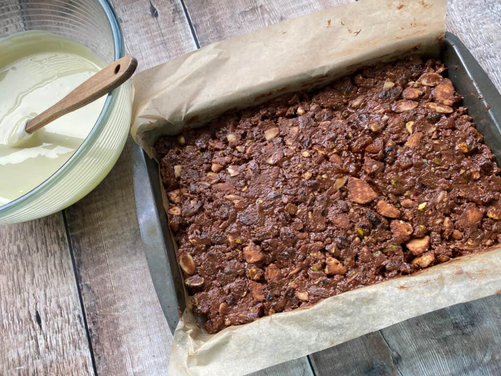 Fruit and Nut chocolate bar mix in a baking tin