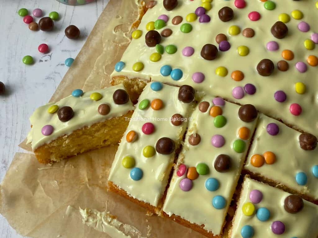 Slices of White Chocolate Tray Bake with a Candy topping.