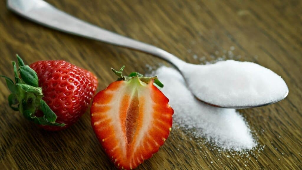 Strawberry is caster sugar and spoon.