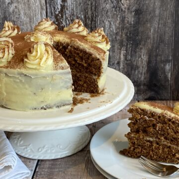 White Chocolate Mocha Cake with a slice cut out on a white plate.