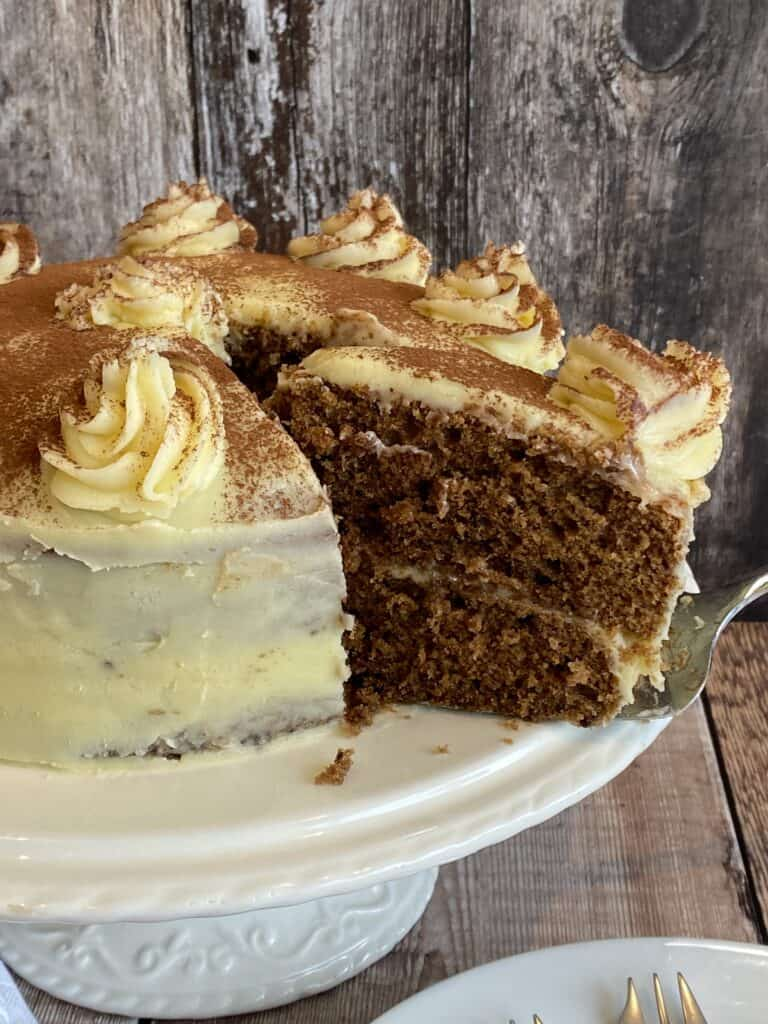 White Chocolate Mocha Cake with a slice cut out.