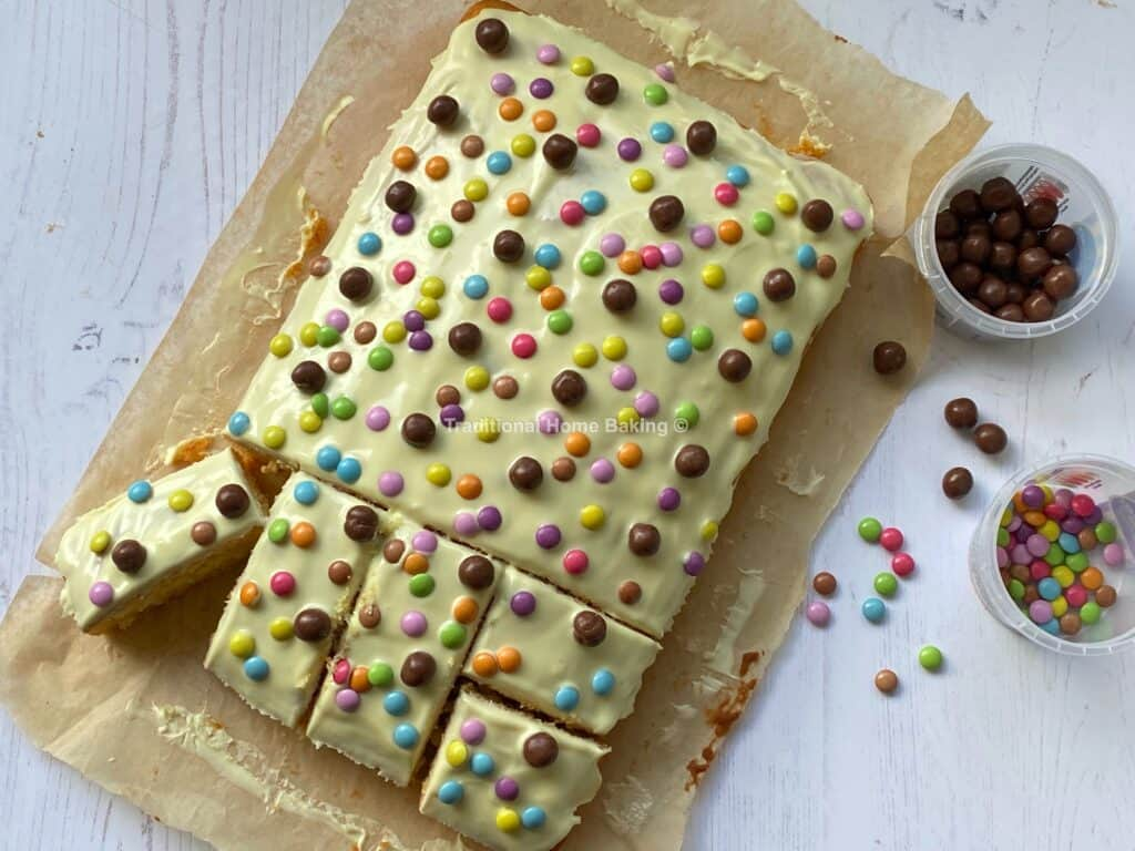 White Chocolate and Candy cake with a slice cut out.
